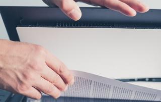 blog_post_header_2016_0055_Hands-of-businessman-copying-document